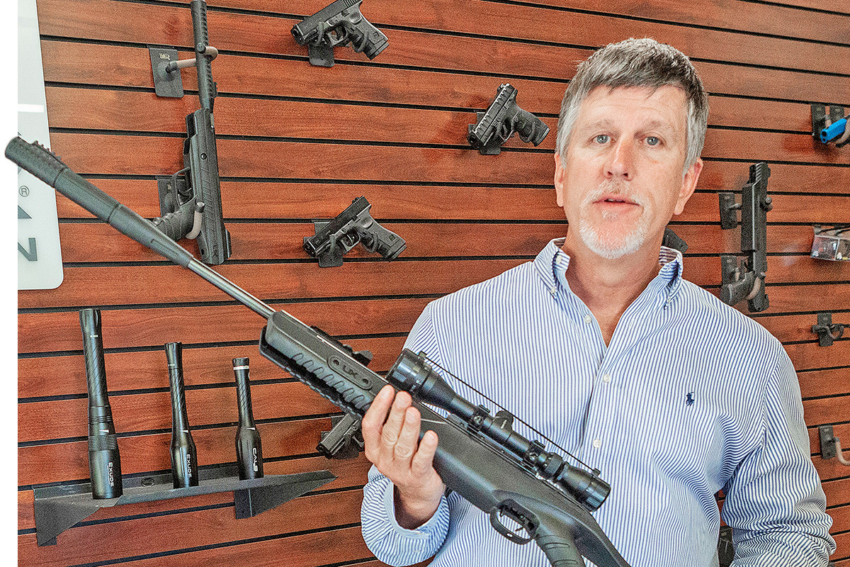 Adam Blalock, CEO of Umarex/Walther, holds one of his company's high-powered air rifles at its corporate headquarters in Fort Smith.
