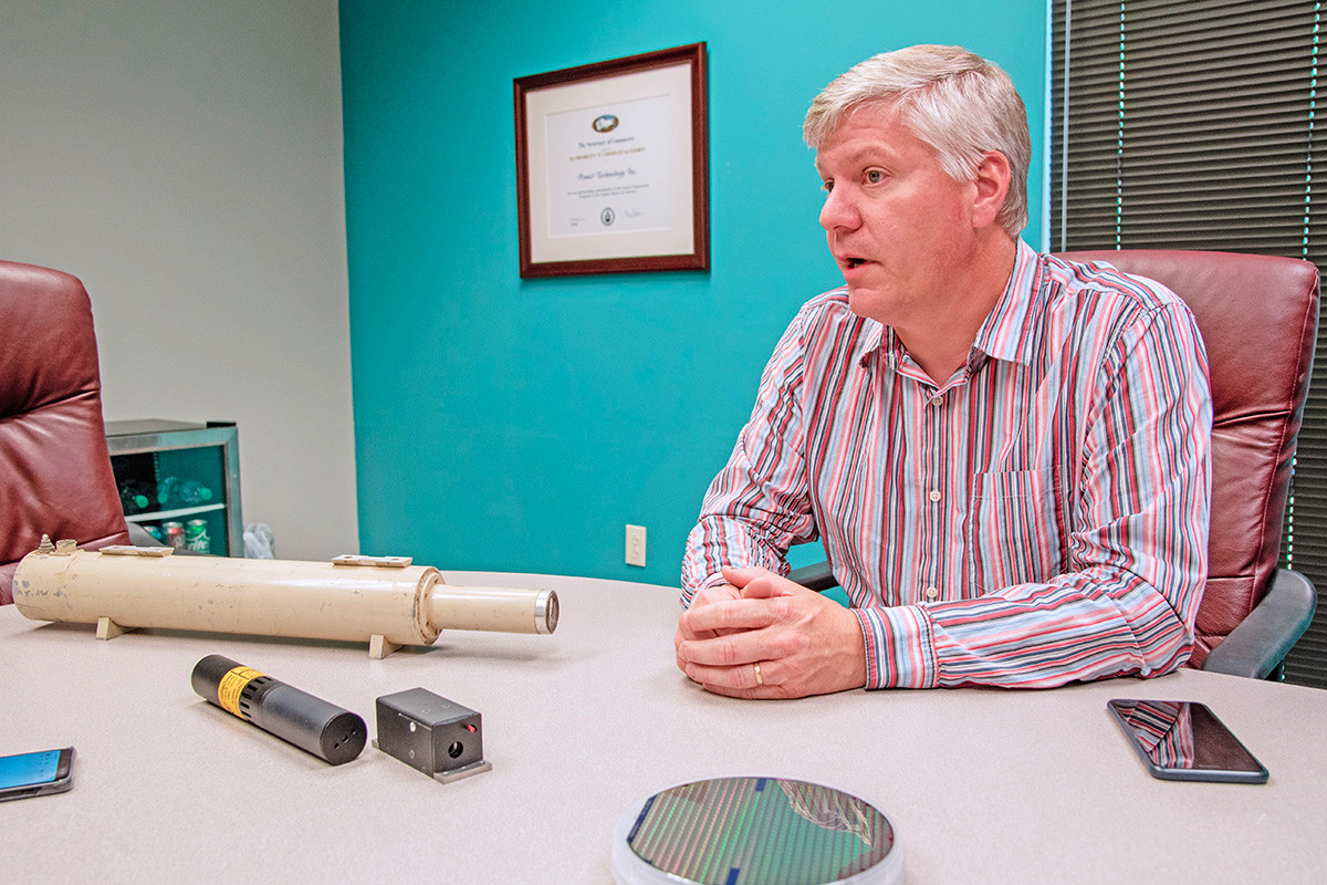 Walter Burgess, vice president of Power Technology Inc. of Alexander, describing the laser technology his company manufactures. A new enterprise, using laser lighting for movie theater projection, is the focus of a company being spun off, tentatively named CinemaLaser.