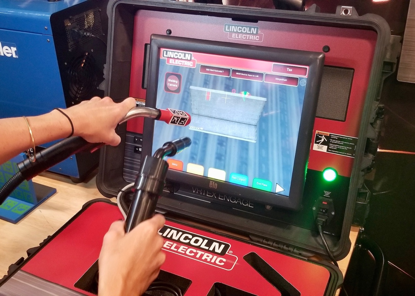 A visitor trys out the welding interactive station aboard the new Be Pro Be Proud workshop.