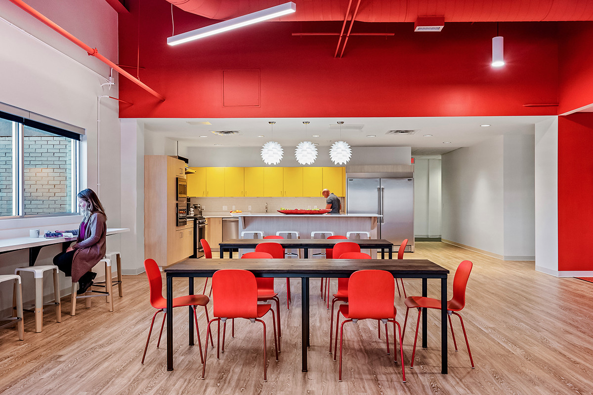 "Interior designer Katie Baldwin of Core Architects believes post-pandemic office spaces will remain open, but with more attention paid to materials that can handle ""rigorous use and cleaning."""