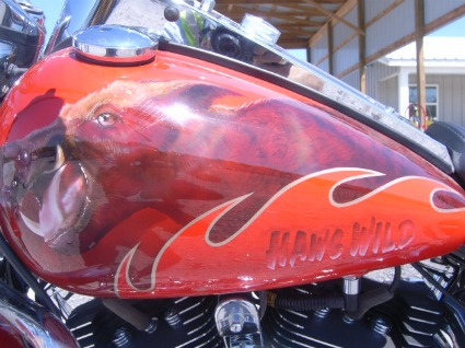 An online auction company is selling Bobby Petrino's wrekced Harley Davidson motorcycle.