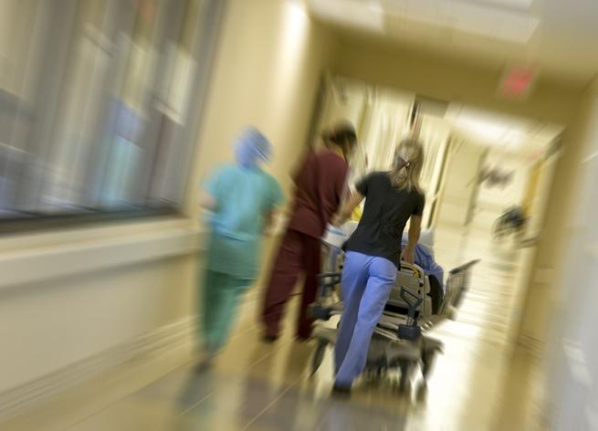 Hospital doctor stretcher hallway patient