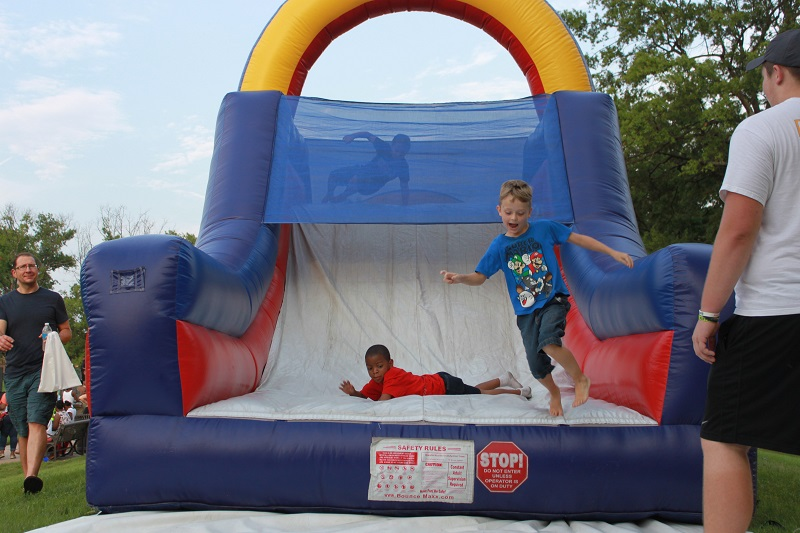 Lamanpalooza, Laman Library, family festival, bounce house, inflatable, slide