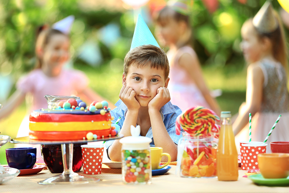 boy at birthday party shutterstock 479604991