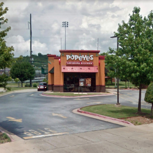 Fort Smith Brokers Spring Chicken Suit on Popeyes Owners